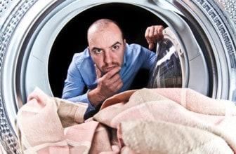 confused man using washing machine