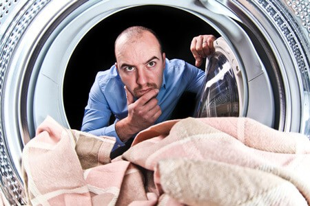 confused man using washing machine