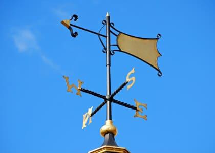 wind vane in blue sky