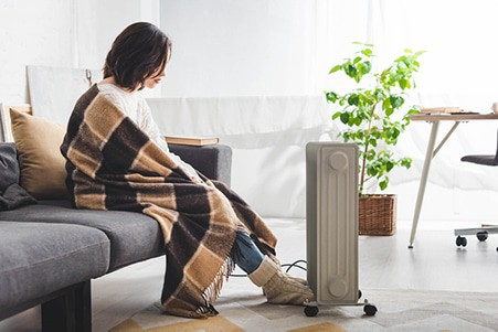 woman beside space heater