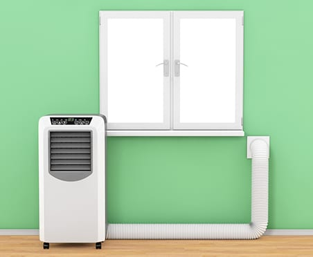 Portable air conditioner with wall vent