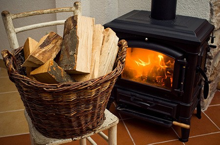 wood stove and basket of logs