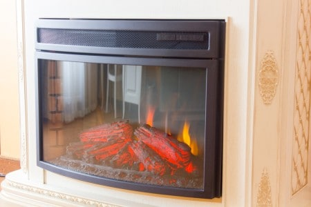 Electric fireplace in room in hotel or motel