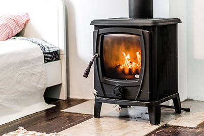 small efficient wood stove in bedroom
